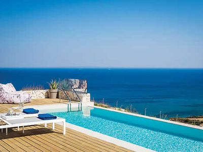 Photo for Ideal for couples and in particular honeymooners, this rare one bedroom villa is in a prime cliff top position, modern and tastefully furnished with  spectacular views along the scenic coastline and out to sea.