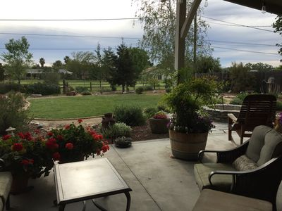 View of backyard and golf course from covered patio