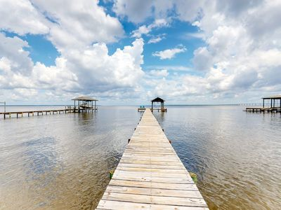 Photo for NEW LISTING! Bright waterfront home w/ a private pool, dock access, and more!