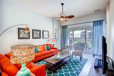 Living area overlooking your very own screened in private pool & spa.