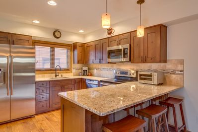 New kitchen with cherry cabinets, granite countertops and stainless steel appliances
