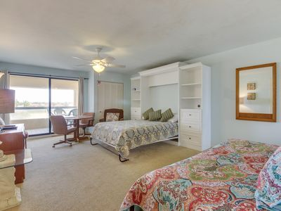Dockside condo with shared pool and hot tub, stunning sunset views!