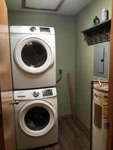 New Stacked Washer and Dryer in laundry room.