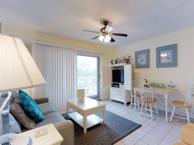 Photo for Relaxing villa w/ ocean views, shared pool & balcony - walk to the beach!