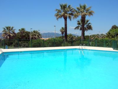 Photo for Beautiful 3 * studio renovated in front of Santa Lucia harbor, Pool, Park, Clim