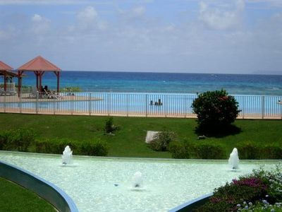 Photo for SPACIOUS APARTMENT PIEDANLO IN THE ANSE OF ROCHERS SWIMMING POOL AND PRIVATE BEACH
