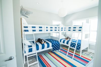 Twin bunk bed room with private full bathroom.