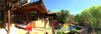 Panorama view from a patio area to the patio dining and pool area