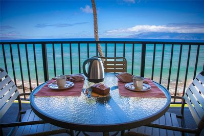 Our favorite place to dine is right here on our oceanfront lanai!