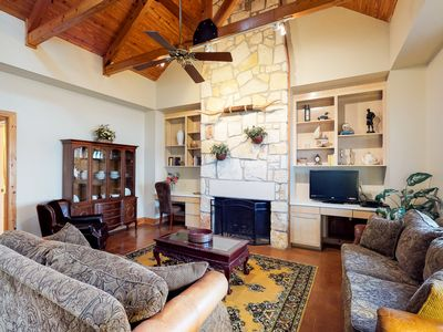 Photo for NEW LISTING! Lake-view waterfront home w/ boat slip, shared pool, & hot tub