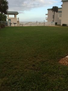 A very few steps across the grass courtyard and you're at the pool/beach!