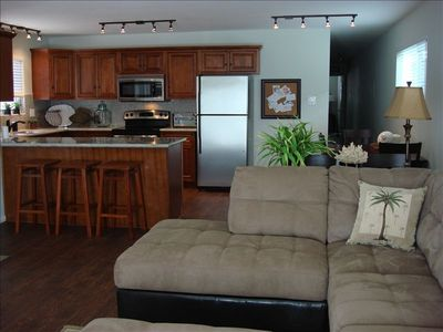 Comfortable living from this cushy sofa to the completely remodeled kitchen
