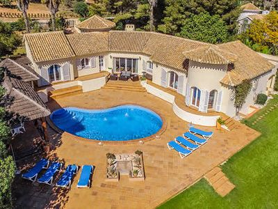Photo for 5 bed, 4 bath Signature villa w/private pool, located next to the golf course, free WiFi & A/C.