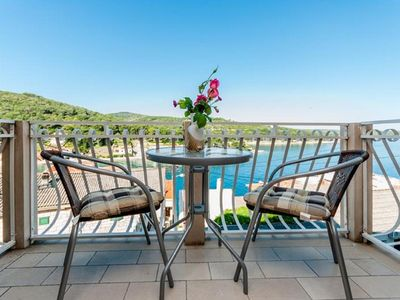 Photo for Two bedroom apartment with terrace and sea view Povlja, Brač (A-2933-b)