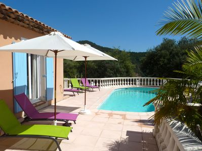 View towards pool from shaded terrace outside kitchen and lounge