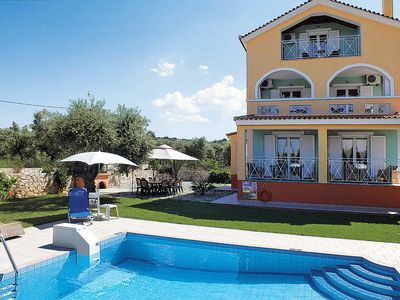 Photo for 4-storied villa amidst olive groves w/ pool 10 minutes from town
