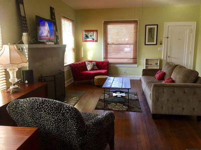 Comfy living room with wood blinds and plenty of seating