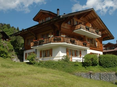 Photo for Luxury apartment on ground floor, 8km from Interlaken, terrace with a view