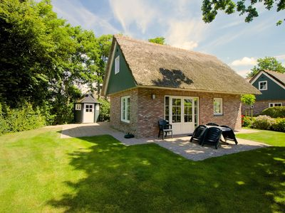 Photo for Detached and very comfortable holiday homes, located on a quiet holiday park 2 km from the North Sea