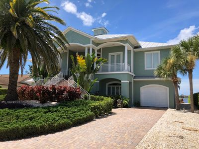 Photo for Bayfront home with pool