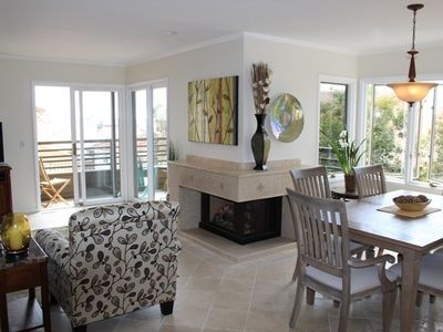Main living space with ocean views from inside living room, dining area, kitchen