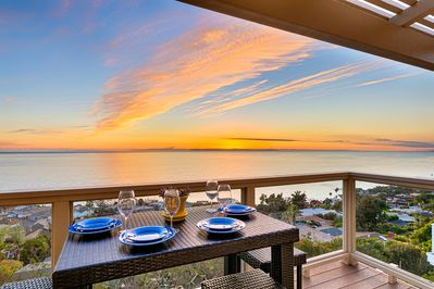 Dine al fresco while watching a beautiful sunset on your private patio.