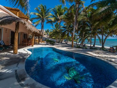 Photo for 4 BR Beachfront home with upscale bedding, pool, Wifi. Close to Tulum.