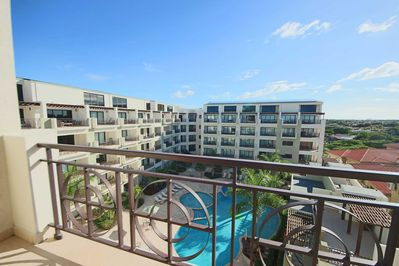 Sit on your spacious balcony and enjoy your amazing pool view