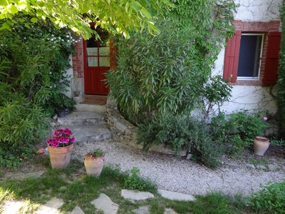 Photo for Mas with swimming pool in a green setting, overlooking the Dentelles.