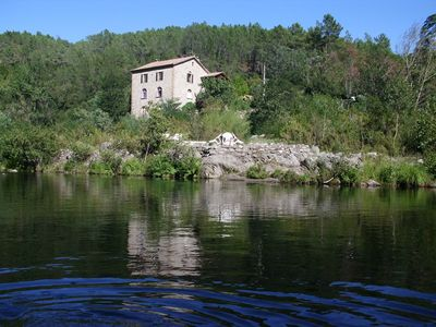 Photo for Former mill cottage by the river, private beach swimming, weekends € 190