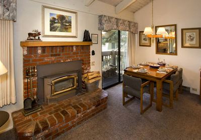 Red brick fireplace and dining room