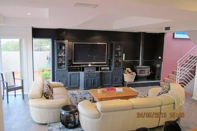 Lounge room with combustion stove
