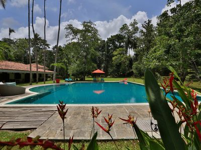 Photo for Near Galle, recent colonial house, 3 bedrooms, large swimming pool in the park