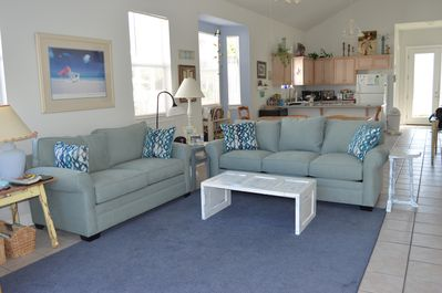Spacious living room with new sleeper sofa and love seat.