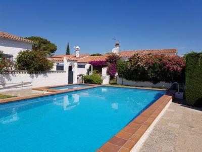 Photo for Pretty independent villa in flower garden with communal pool