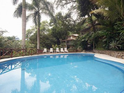 Photo for House in gated condominium Polynesian style, 250m from the beach, with pool.