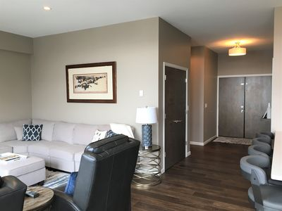 Large entry with hall to bedrooms 2 & 3, laundry room & coat clo