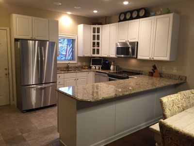 Remodeled kitchen with new quartz countertops and stainless steel appliances