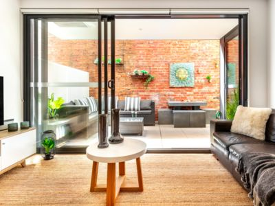Photo for Chic Sth Melbourne Apartment with Huge Private Courtyard