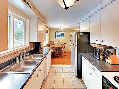Kitchen - The kitchen is equipped with a full suite of appliances for all of your culinary needs.