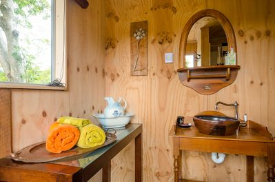 Bathroom/Shower. No power or heating. Gas hot water. Light. 30mtrs from bedroom.