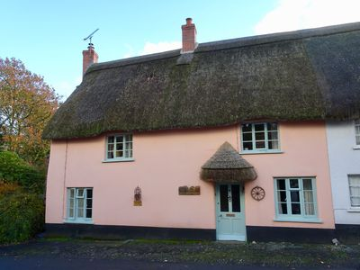 Photo for Sixteenth century thatched cottage in picturesque Devon village. Pets welcomed.