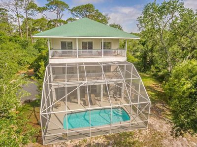 """Photo for Beautiful Plantation home with Private Pool and short walk to Gulf Beaches, 4BD/4BA  """"A Hidden Treasure"""""""