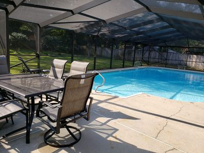 Photo for Private Getaway with Screened Pool, Upscale Kitchen, & Large Private Fenced Yard