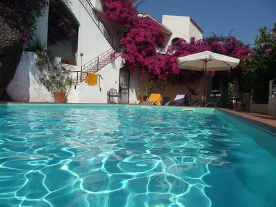 Photo for Villa with pool and garden above Taormina, stunning views of the bay and Mt.Etna