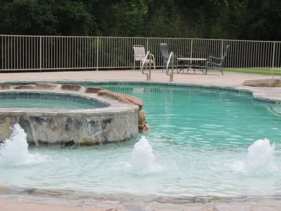 Our river bottom pool and hot tub surrounded by the 5 acres of trees.