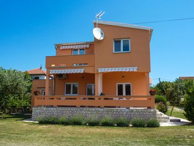 Photo for Holiday apartment with air conditioning, satellite TV and sea view