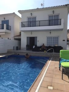 Front of house with swimming pool view .