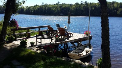 Photo for Amid nature, charming,romantic,fun! boats,2 docks,fireplace, SWest view,sunsets!