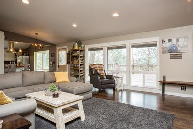 Living Room with BEAUTIFUL view right out to the deck and overlooking Medford.
